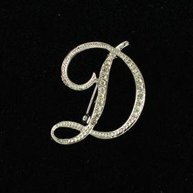 initial brooch D