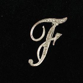 initial brooch F
