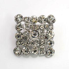 small square brooch